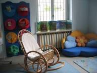 Foto sala bambini con sedia a dondolo
